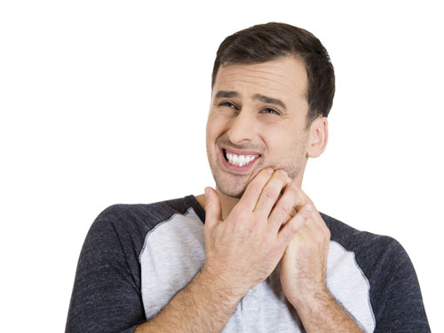 A man suffering from a painful toothace.
